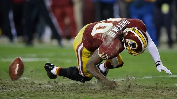 Washington Redskins quarterback Robert GriffinIII reinjures his knee while reaching for a loose ball during the second half of the wild card playoff game against the Seattle Seahawks Sunday in Landover, Md.