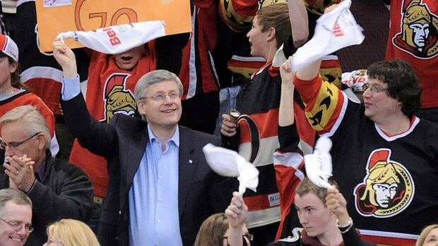 Prime Minister Stephen Harper, cheering on the NHL's Ottawa Senators in 2012, will publish his long-awaited book tracking the history of professional hockey in November.