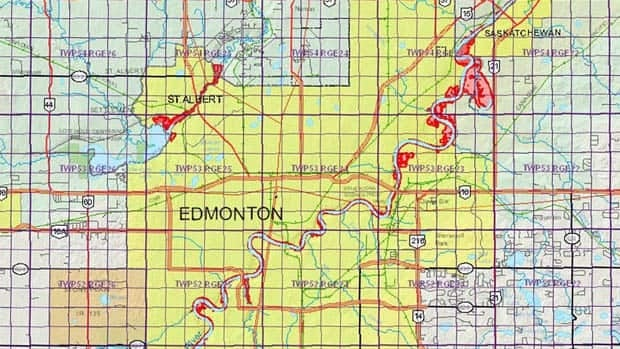 Areas identified as floodways (red) and flood fringes (pink) are most dramatically evident along the North Saskatchewan River in northeast Edmonton and along the Sturgeon River in St. Albert.