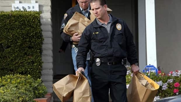 Investigators served a search warrant at the home of Christopher Dorner's mother in La Palma, Calif., on Friday, while authorities continued their manhunt for the fired policeman who is suspected of killing 3 people.