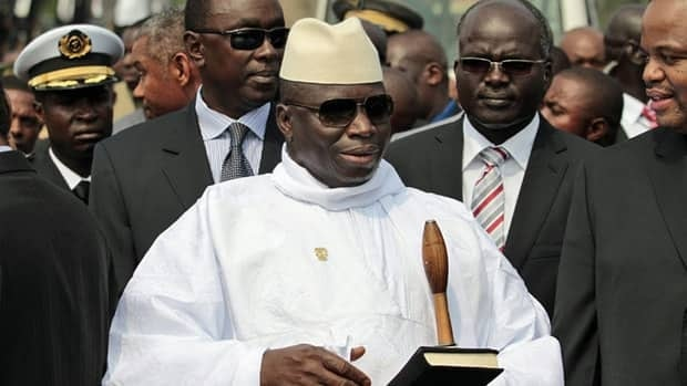 Gambian President Yahya Jammeh, center, is seen during a visit to Equatorial Guinea in 2011. The president has vowed to execute all inmates on death row by mid-September.