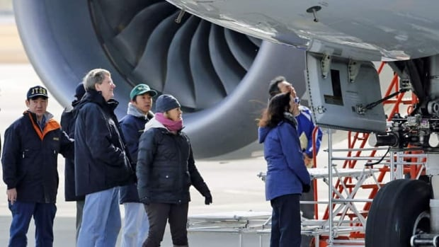 A team of experts inspect a 787 Dreamliner after a fire in 2013. Canada has followed the ICAO in banning shipment of lithium metal batteries in cargo holds.
