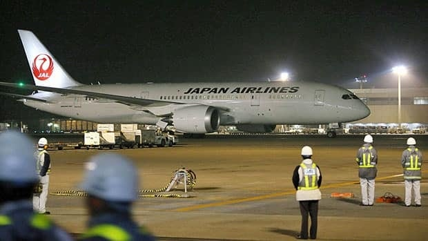 A Japan Airlines' 787, which encountered a fuel leak a day earlier, arrives in Narita airport. The investigation into the fires on the Boeing Dreamliners has turned to the maker of the battery monitoring system