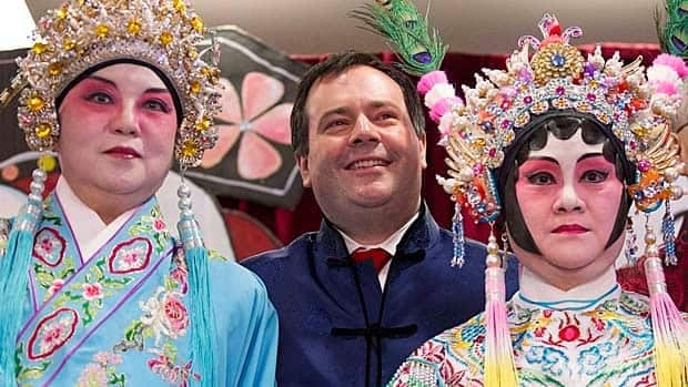 Multiculturalism Minister Jason Kenney stands on stage with Chinese opera performers during a photo opportunity at the Mon Sheong long-term care centre in Richmond Hill, Ont. last month.