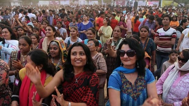 Women in Ahmadabad, India, dance in support of the One Billion Rising global campaign calling for an end to violence against women and girls.