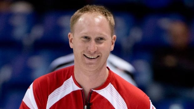 Canada skip Brad Jacobs smiles during an easy victory over Switzerland's Sven Michel  Monday at the men's world curling championship in Victoria, B.C.