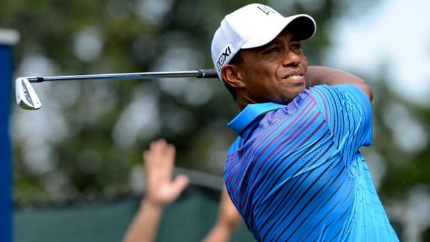 Tiger Woods hits his tee shot on the third hole during the second round of The Barclays in Farmingdale, N.Y. on Friday.