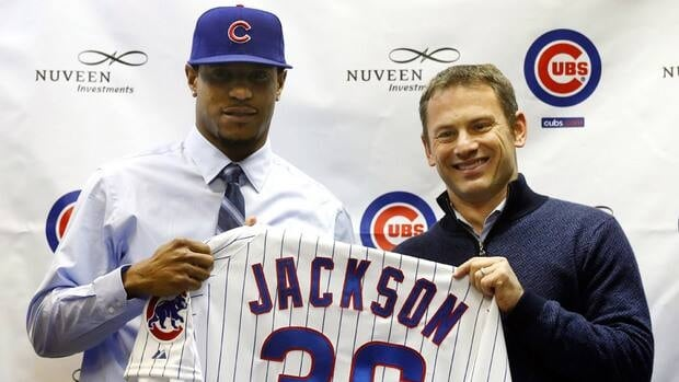 Chicago Cubs general manager Jed Hoyer, right, poses with newly signed right-handed pitcher Edwin Jackson during a news conference announcing Jackson's four-year, $52 million US contract at Wrigley Field on Wednesday.