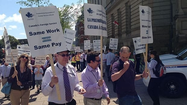 Striking foreign service officers demonstrated outside Prime Minister Stephen Harper's office in Ottawa on Tuesday.