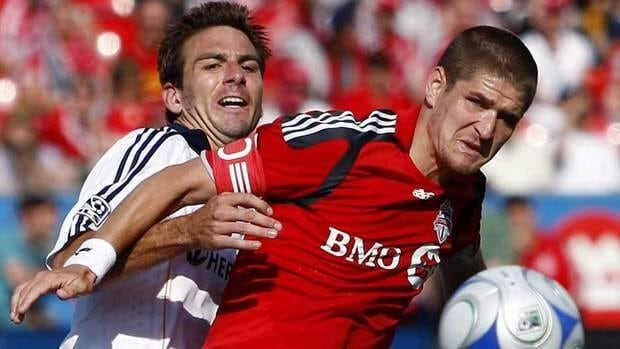 Carl Robinson, right, was twice named Toronto FC's most valuable player.