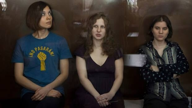 Russian police have arrested a suspect they say tried to link a double homicide with the jailing of feminist punk group Pussy Riot - from left, Nadezhda Tolokonnikova, Maria Alekhina and Yekaterina Samutsevich.