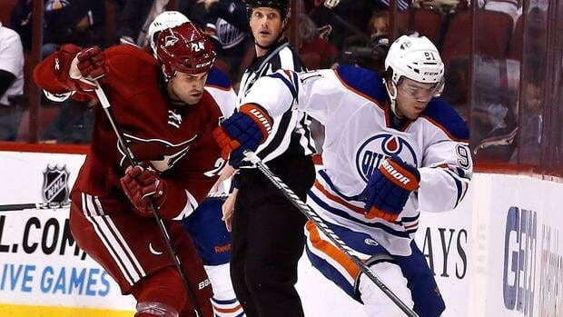 Edmonton Oilers' Magnus Paajarvi, right, during a game against the Phoenix Coyotes Wednesday, Jan. 30, 2013, in Glendale, Ariz.