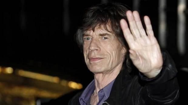 Mick Jagger waves to fans as he arrives at the Trabendo concert hall in Paris for a surprise warm-up gig on Oct. 25. The Rolling Stones have added a fifth concert on their the upcoming series.