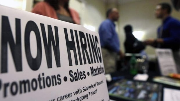 Job-seekers attend a job fair in Colonie, N.Y. in October 2012. While overall hiring currently remains far below pre-recession levels in the United States, fewer layoffs have led to an improved job market over the last six months.