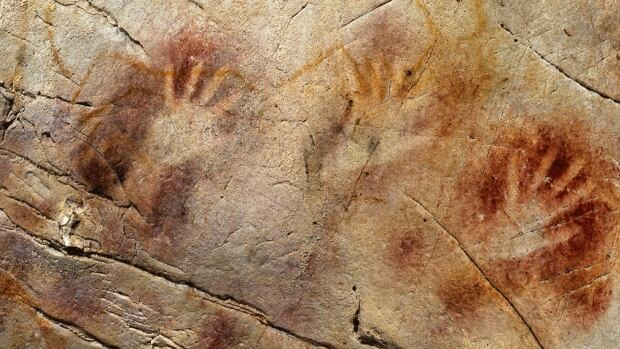 A 'panel' of hand stencils is shown in the El Castillo Cave in Spain. Nearby 'disc' paintings were shown to be older than 40,800 years, making the works the oldest oldest known cave art in Europe.