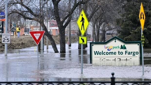 The Fargo, N.D., welcome sign sits in floodwaters in April 2011.