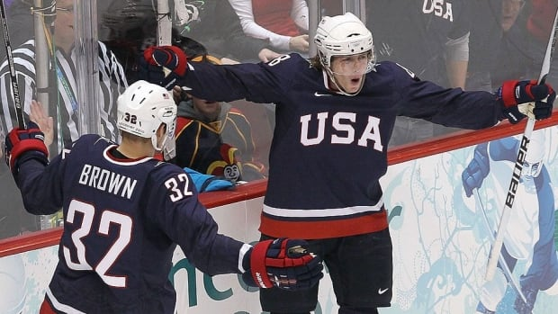 Patrick Kane, right, and Dustin Brown, left, celebrate a Kane goal during semifinal action at the 2010 Vancouver Olympics. They'll be key members of the United States team that competes at the 2014 Winter Games in Sochi, Russia.