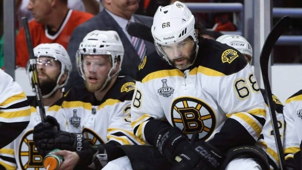 Boston Bruins winger Jaromir Jagr, right, reacts after a goal by the Chicago Blackhawks in Game 5 Saturday night.