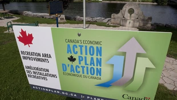 A government action plan sign is seen in Mississippi Mills, Ont. An examination by The Canadian Press reveals ad budgets geared to promoting economic success have soared under the Conservatives since the 2008 global downturn.