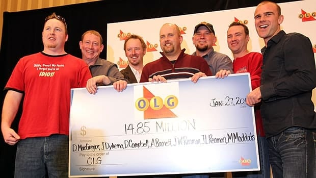 On Jan. 27, 2011, seven years after a lottery ticket was stolen, the rightful winners got the money. From left to right: Joseph Reaman, James Reaman, Michael Maddocks, Daniel MacGregor, Jason Dykema, Daniel Campbell and Adam Barnett.