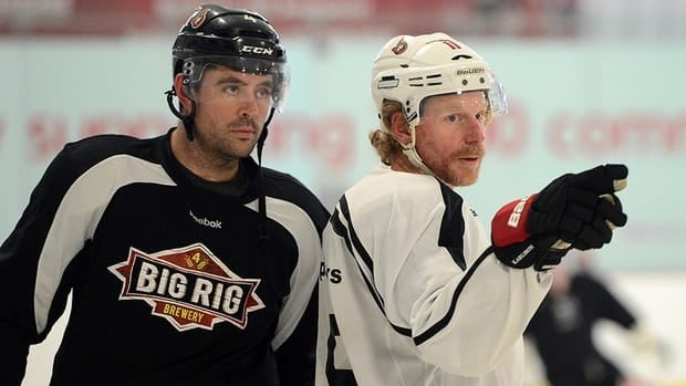 Ottawa Senators Daniel Alfredsson, right, and Chris Phillips practice at the Bell Sensplex in Ottawa on Monday. Sens head coach Paul MacLean, who spoke to the media, said his coaching staff has been working on game plans for months.