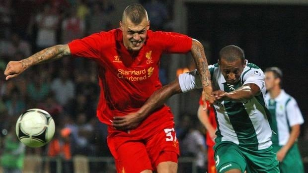 Liverpool's Martin Skrte, foreground, vies for the ball with Gomel's Alexander Aluhona during their Europa League qualifying match on Thursday. Liverpool won the first leg.