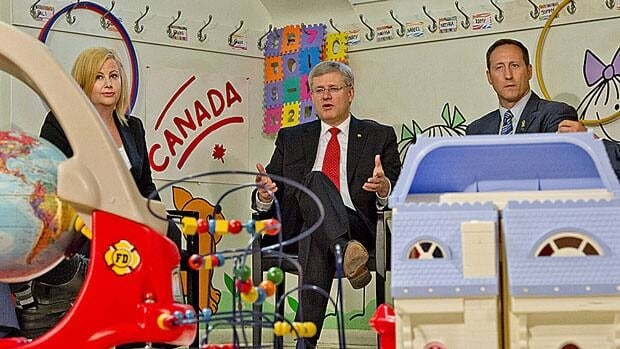 Prime Minister Stephen Harper says his government will introduce new legislation to impose stricter sentences on child sexual predators. Harper visited a daycare centre in Toronto Thursday with Justice Minister Peter MacKay, right, and Lianna McDonald, executive director of the Canadian Centre for Child Protection.
