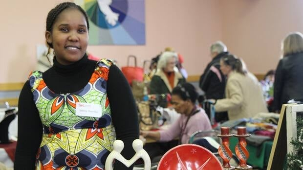 Kenyan-born Selbina Mwendwa sells soapstone crafts from her home village at the 2012 edition of the Hamilton International Women's Centre's International Marketplace.