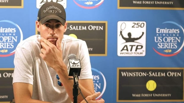 John Isner, two-time Winston-Salem Open winner, announced at a press conference that he was withdrawing because of an injury on Monday.