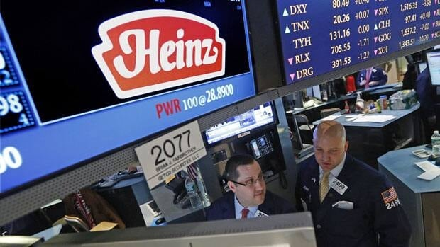 Traders work at the post that trades H.J. Heinz Co. on the floor of the New York Stock Exchange on Thursday.
