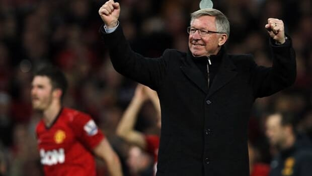 Manchester United's manager Alex Ferguson celebrates after his team clinched the English Premier League soccer title with a win against Aston Villa at Old Trafford in Manchester, northern England, on April 22.