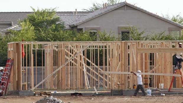 Workers frame the first home in a new Trend Homes community in Gilbert, Arizona, near Phoenix. Real estate experts say the metro Phoenix metro housing market is recovering faster than other U.S. cities, bolstered by an upswing in home prices and rising sales, with Canadian buyers playing a big role.