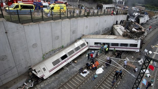 Rescue workers pull victims from a train crash near Santiago de Compostela in northwestern Spain.
