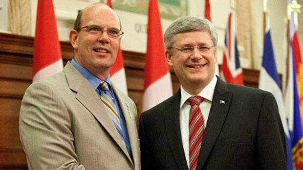 Conservative MP David Wilks shakes hands with Prime Minister Stephen Harper. Wilks issued a statement Wednesday aimed at clarifying his support for the budget bill, which was thrown into doubt following a media report.
