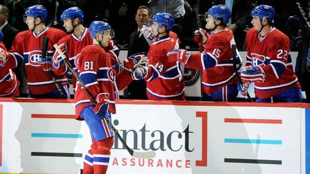 Lars Eller, centre, of the Montreal Canadiens celebrates his first period goal with teammates during their win over the Minnesota Wild on Thursday.