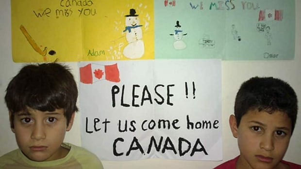 Adam and Omar Benhmuda, who were born in Canada, are pictured on the petition sponsored by their Mississauga, Ont., school friends and neighbours earlier this year. (Courtesy of Benhmuda family)