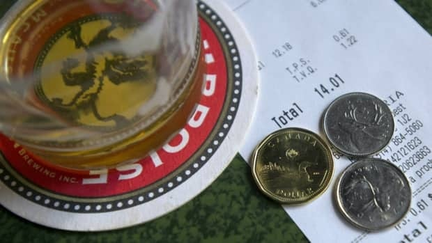 A Calgary etiquette expert says the standard tip in this city should be 20 per cent for good service.