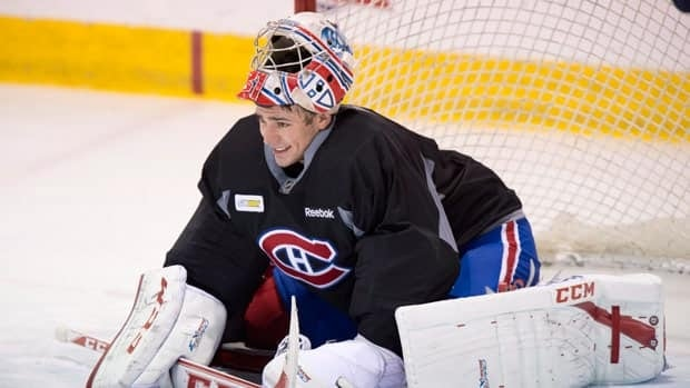 Carey Price stretched during this Montreal practice session, but it didn't stop a nagging injury from occurring two days before the puck dropped on the season.