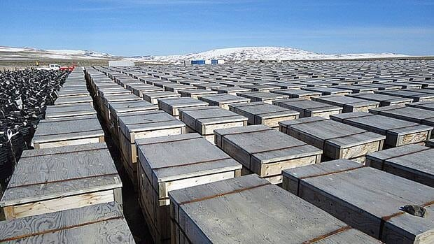 Thousands of containers of contaminated soil and other waste sit at an old Distant Early Warning System site at Cape Dyer, Nunavut, awaiting transport south in July, 2011. DEW line sites are some of the 142 contaminated sites that required clean up across Canada according to the most recent data.