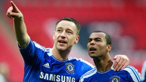 Chelsea's John Terry, left with teammate Ashley Cole gesture towards the crowd as they celebrate winning the FA Cup in May. Cole testified in Terry's defence at a trial in London on Wednesday.