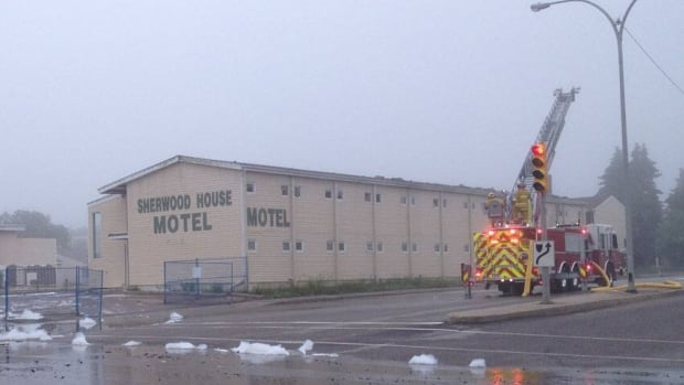 By 6, the fire was out. Scorch marks remained on the main building at the Sherwood House Motel.