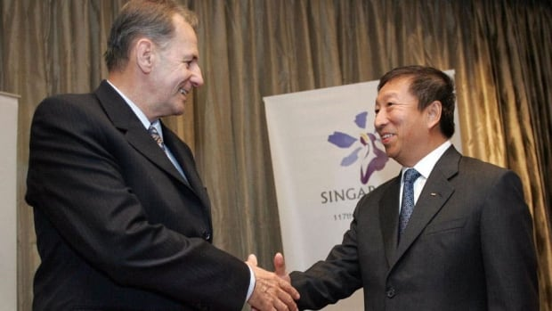 Singapore's Ng Ser Miang, right, shakes hands with International Olympic Commitee President Jacques Rogge. Ng wants to succeed Rogge and become the first Asian to head up the IOC.