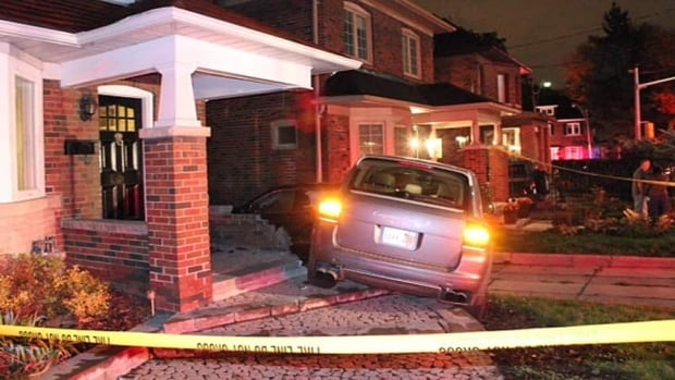 A Porsche Cayenne SUV crashed into a Toronto home early Monday morning, taking out part of a wall attached to the front porch.