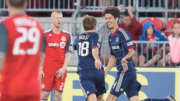 Chicago Fire's Avaldo Fernandez (right) celebrates with Chris Rolfe after scoring his team's first goal in Toronto on Wednesday.