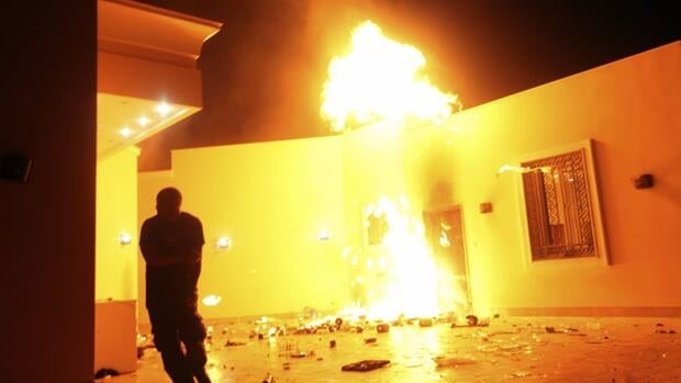 The U.S. consulate in Benghazi is seen in flames during an attack on September 11, 2012. Newly released documents shed light on how the Canadian Department of Foreign Affairs responded following the attack.