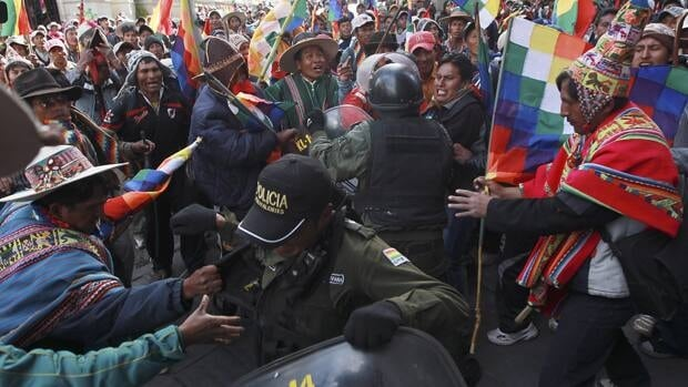 Members of indigenous communities from Malku Kota region, march during a protest in La Paz, Bolivia, Thursday. The protest was against mining operations on their lands by the Canadian mining company South American Silver Corp.