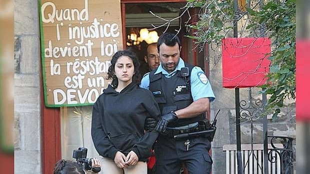 Yalda Machouf-Khadir, daughter of Quebec MNA Amir Khadir, is led out of the family's home by police Thursday morning.
