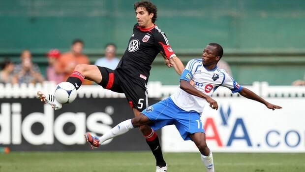 Dejan Jakovic, left, of D.C. United controls the ball against Sanna Nyassi of the Montreal Impact during Saturday's match.