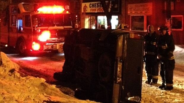 Emergency crews tend to a rollover Monday at Westminster Avenue and Walnut Street in Winnipeg.