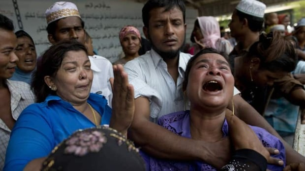 A mother of a mosque fire victim cries during the burial of her son on the outskirts of Rangoon, Burma. A fire engulfed a mosque housing Muslim schoolchildren in the country's largest city on Tuesday, killing at least 13.